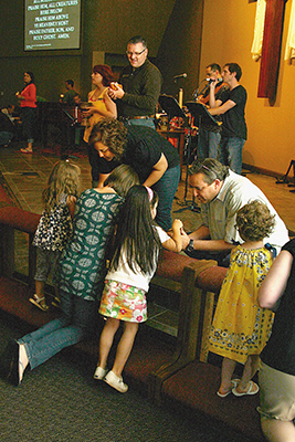 Holy Communion is celebrated on a Friday night at Acts 2 United Methodist Church in Edmond.