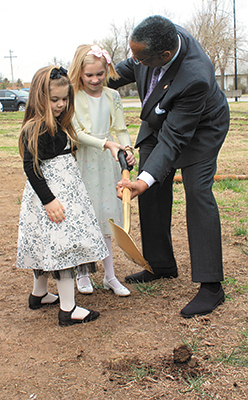 Working together to break ground for Moore-First's Christian Life Center are, from left, Ally Gossett, Courtney Acord, and Bishop Hayes. Photo by Thomas Maupin