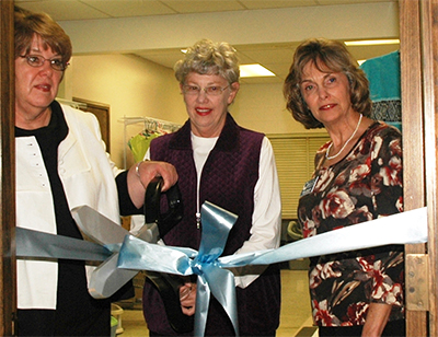Cutting the ribbon to open the Child SHARE co-op in Ponca City are, from left, Becky Hightower, Kay Grimme, and Mary Buresh.