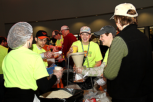 "Volunteers prepare a recipe using dried ingredients, including rice, during the ""Stop Hunger Now"" event at OKC-Church of the Servant"