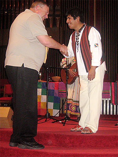 Pastor Robert Rose greets a member of Anyi, a folk-music group from Bolivia, when their tour stopped at his church, OKC-Chapel Hill UMC
