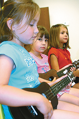 Project Transformation invests in children by reinforcing reading and other skills during summer. These girls learned about music using ukuleles provided through a grant by the Foundation to Bartlesville-Oak Park UMC, one of the project's sites.