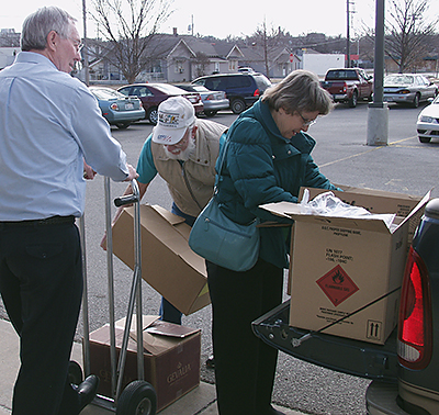 VIM's Gene Brantley, left, helps Rob and Vera Walton unload health kits from Lamont UMC.