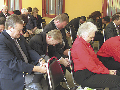 Oklahoman and Mexican church leaders pray during the Dec. 2 covenant service at Rio Bravo, Mexico. Assisted by