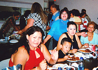 An ethnic meal draws a crowd at Nueva Esperanza church in Tulsa during a weekend of anniversary activities.