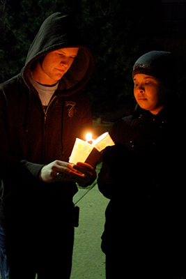 OCU students light candles of remembrance during the World AIDS Day observance on campus.