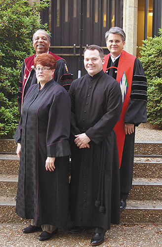 Front row, newly ordained deacons Harriette Kemp, left, and Kristopher Tate stand June 1 with Bishop Robert Hayes Jr. and Michael Burkett, Board of Ordained Ministry chair.